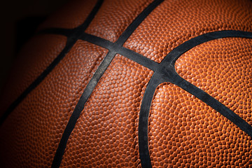 A close-up of a leather basketball on white