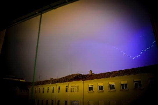 Lightening Over Buildings In City At Night