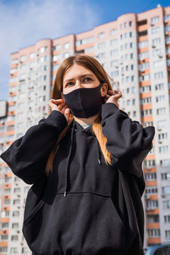 Masked woman - protection against influenza virus. European - American woman wearing mask for protect. Woman wear with protective face mask on a street. Stop the virus and epidemic diseases.