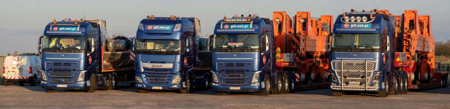 special convoy consisting of GTT trucks carrying heavy container unloading machines.Stargard, Poland-April 2020