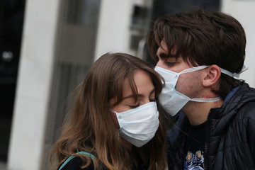 Marco Donoso del Bufalo, 20, a young man on the autism spectrum, kisses his sister Irene, 22, as they take their daily walk during the lockdown amid the coronavirus disease (COVID-19) outbreak in Madrid