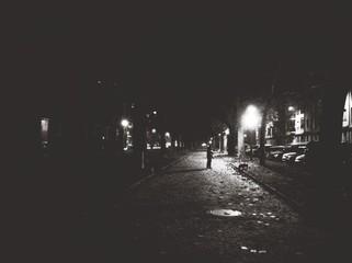 Fototapeta Man Standing On Road In The Dark