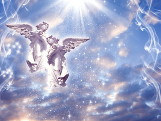 Wall Mural - two angels archangels with  divine rays of light stars and mystical sky like spiritual religious and angelic concept  with copy space