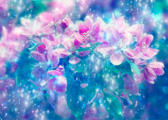 Wall Mural - spring tree branch with pink flowers and leaves and magic stars, spring blossoming tree in mystical magical starry stars