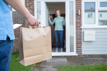 Home Delivery Of Takeaway Food Outside House Observing Safe Social Distancing During Coronavirus Covid-19 Pandemic