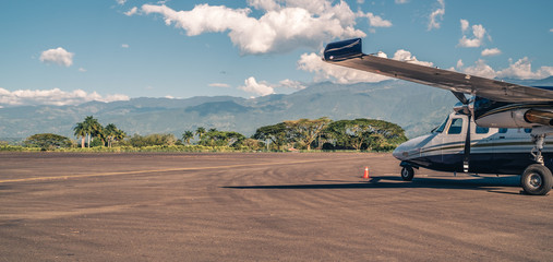 Twin engine propeller plane on the runway of the international airport  of Armenia, Quindio,  Colombia.