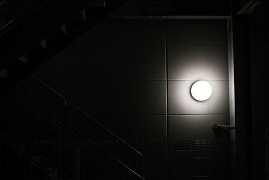 Illuminated Sconce On Wall In Building
