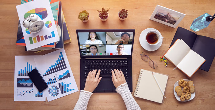 work from home. people make video conference with multi colleague via laptop computer during self isolation to avoid spreading illness transmission of COVID-19 Coronavirus outbreak. Social distancing
