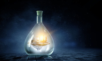 Wall Mural - Energy plant inside a glass bottle