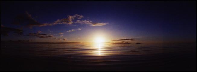 Fototapeta View Of Calm Sea At Sunset