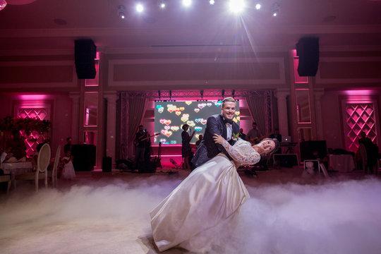 Beautiful wedding couple dancing together