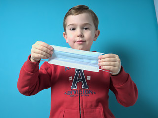 Child with a surgical protective mask