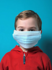 Child wearing a surgical protective mask