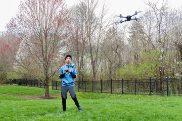 Young Boy Flying His Drone Outdoors in Spring