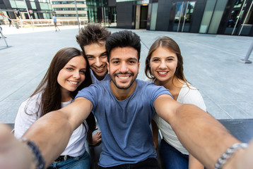 Group of friend taking a selfie picture together, point of view