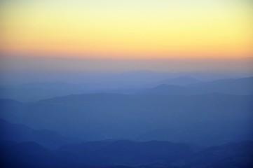 Foto auf Gartenposter Gelb Schwefelsäure Countryside Misty Landscape Against The Sky
