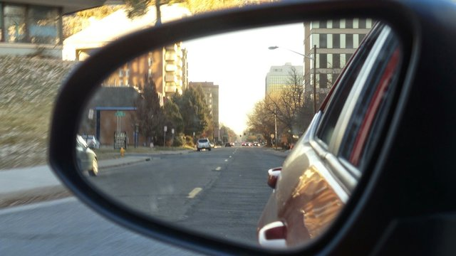 Reflection Of Road On Side View Mirror Of Car