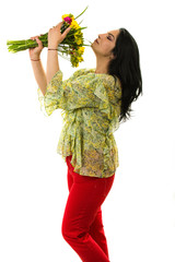Beauty woman smelling freesia bouquet