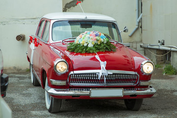 Canvas Prints American Famous Place Unusual front headlight, old burgundy red car for any purpose . Red vintage wedding car parked . Wedding bouquet on vintage wedding car .