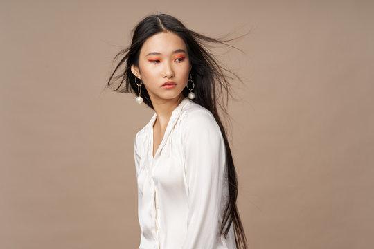 Beautiful elegant woman charm bright makeup beige background Studio Model