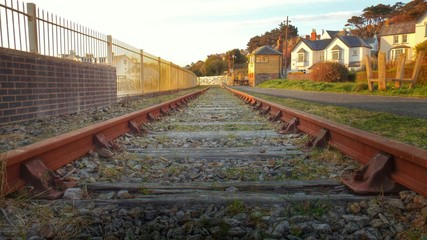 Railroad Tracks By Houses