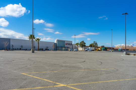 Victorville, CA / USA – April 13, 2020: View of the parking lot at the Mall of Victor Valley and Macy's in Victorville, CA, during the temporarily closure due to the COVID-19 crisis.