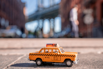 Wall Mural - Taxi model parked on the Washington street in Brooklyn, New York.