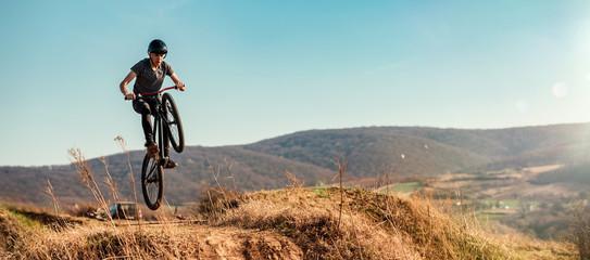 Dirt bike rider jumping in bike park on mountain bike Wall mural