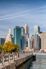 Wall Mural - NEW YORK CITY - OCTOBER 2015: People walk along Brooklyn Bridge Park, USA