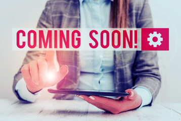 Word writing text Coming Soon. Business photo showcasing event or action that will happen after really short time Business concept with communication mobile phone