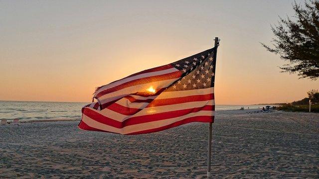 American Flag Flying Against Scenic Sunset