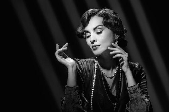 Fashion portrait of beautiful brunette woman wearing luxury jewelry