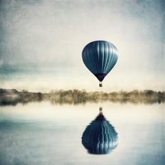 Fototapeta Blue Hot Air Balloon Flying Over Calm Lake obraz