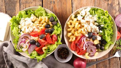 Fotobehang - buddha bowl- vegetable bowl salad with tomato, pasta, cheese, onion