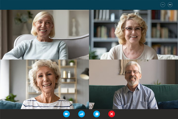 Four Caucasian middle-aged 50s people involved at group video call conference, laptop webcam head...