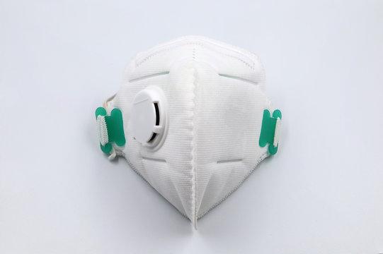 White medical mask isolated. Face mask protection against pollution, virus, flu and coronavirus on white background.
