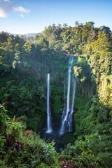 Triple waterfall in the green rainforest of Bali, Indonesia