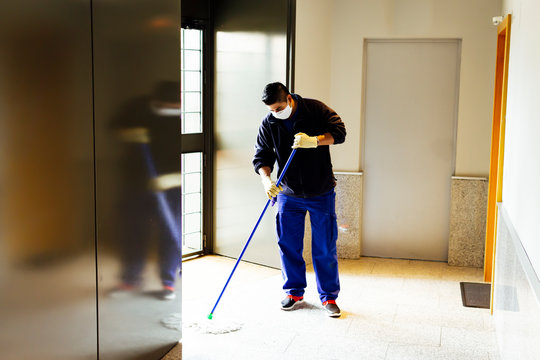 coronavirus. cleaning staff disinfecting the floor with bleach to avoid the spread of the virus