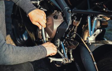 Fotobehang - Mechanic working in garage. motorcycle Repair service.