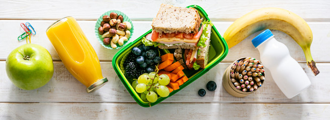 Back to school concept - lunch box with juice, apple and banana, copy space Papier Peint