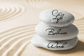Photo sur Toile Zen pierres a sable Work-life balance concept. Stacked stones on sand with pattern