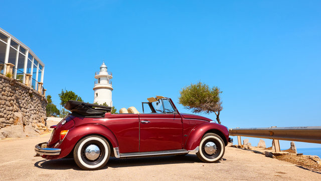 Mallorca, Spain - August 20, 2018: Beetle Cabriolet 1303 parked by Cap Gros lighthouse.