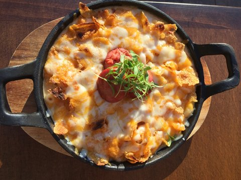 High Angle View Of Chorizo Mac And Cheese Served On Table