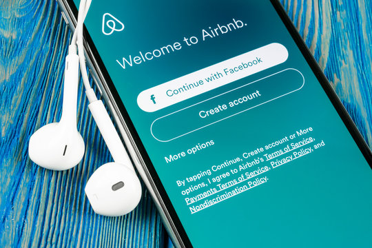 Helsinki, Finland, May 4, 2019: Airbnb application icon on Apple iPhone X screen close-up. Airbnb app icon. Airbnb.com is online website for booking rooms. social media network.