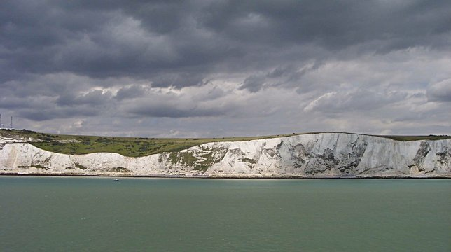 Scenic View Of White Cliffs Of Dover Against Cloudy Sky