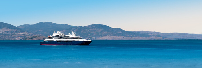 Wall Mural - Side view of small cruise ship on the Aegean Sea. Panorama.