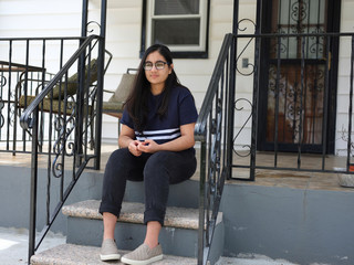 19-year-old Minnoli Aya, who lost her mother Madhvi, a healthcare worker, during the outbreak of the coronavirus disease (COVID19), looks on in Floral Park, New York