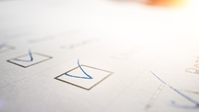 Person Ticks Checkbox Marks with a Pen, filling up To Do List. Checking Marks and FIlling in a Task List / Questiannaire / Medical Cart. Moving Macro Close-up Camera