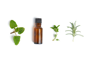 Wall Murals Condiments Bottle with herb essential oil on white background. Flat lay concept.