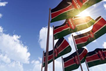 Kenya flags waving in the wind against a blue sky. 3D Rendering Wall mural